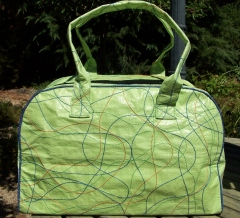 Fair trade overnight bag made from recycled rice bags.