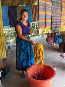 Francisca holding just-dyed yarn.