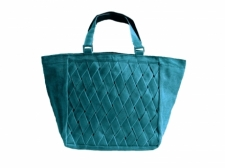 Large, turquoise fair trade tote hand sewn from re-purposed netting material used in the fishing industry.
