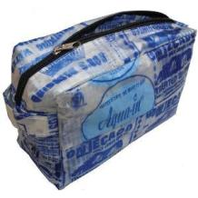 Toiletries bag made from re-purposed water pouches by fair trade workers in Ghana.