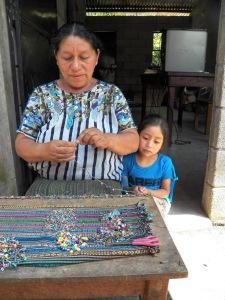 Fair trade jewelry artisan in Guatemala.